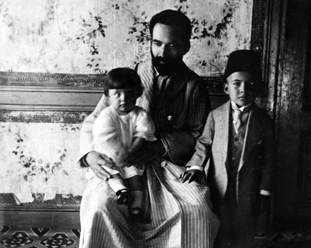 At age six, with his father Mehmet Necati Bey and sister Sabahat, 1922.