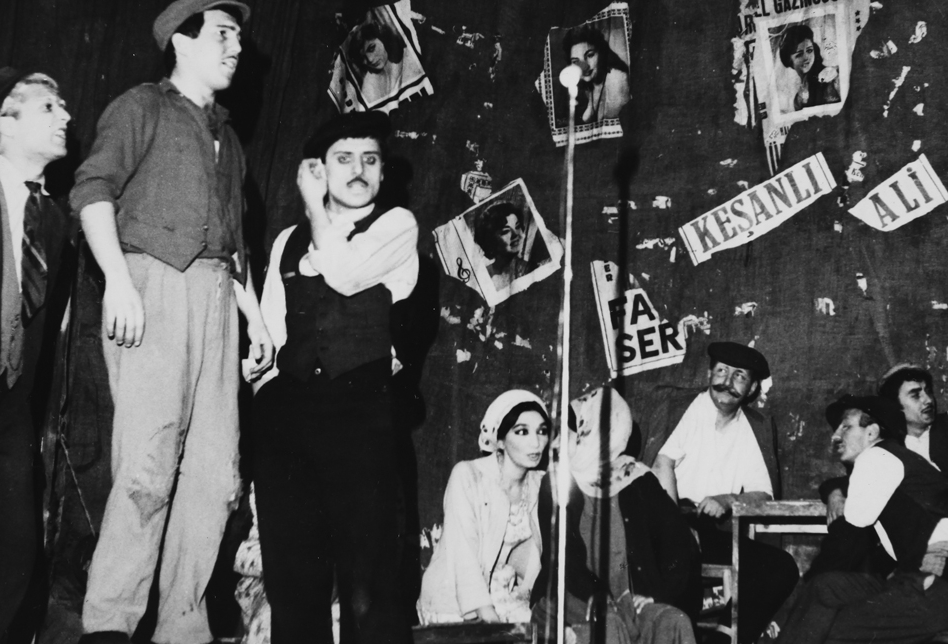 In the Play of Keşanlı Ali. Haldun Taner played a painter character just for one time(sitting by the wall with moustache)