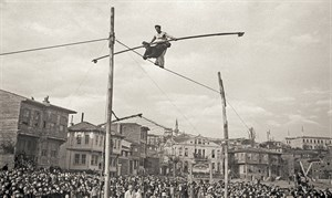 Two acrobats in Little Hagia Sophia neighborhood, Fatih, Istanbul, around 1930. Yapı Kredi Historical Archive